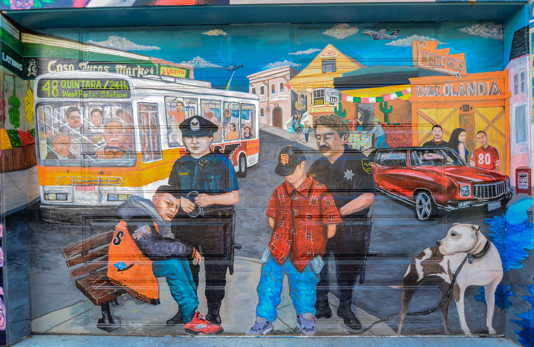street art of two cops arresting youth immigrants in the Mission district