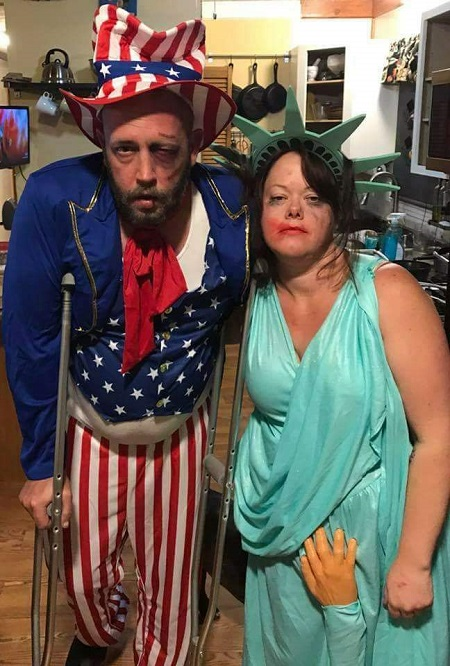 "two costumes of ""currently abused government"": uncle sam all beat up, and a groped statue of liberty"