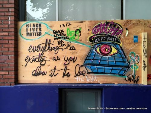 """Hand-painted sign: """"Everything's as you allow it to be."""""""